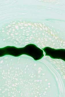 Boue de feu vert abstraite dans l'huile
