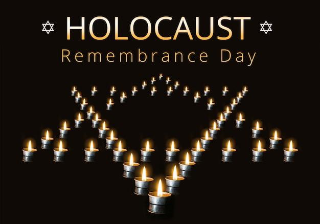 Bougies allumées sur fond noir, texte journée internationale du souvenir de l'holocauste, 27 janvier. l'étoile de david bordée de bougies dans la nuit, sur fond noir.