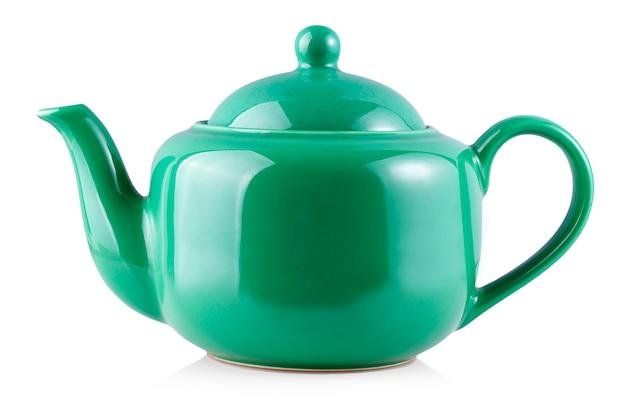 La bouilloire de théière verte isolée sur blanc