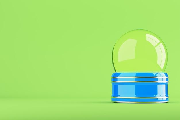 Une boule à neige bleue vide sur fond vert