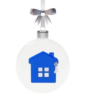 Boule de noël transparente avec l'icône de la maison bleue à l'intérieur