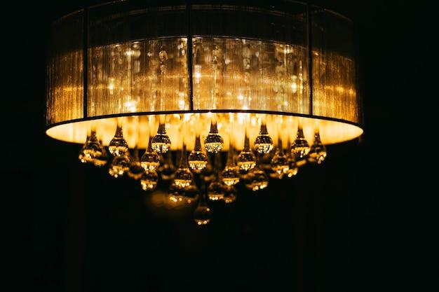 Boules de verre de lustre électrique d'éclairage en cristal une sphère émettent une lumière orange chaude