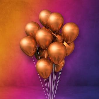 Bouquet de ballons en cuivre sur une surface arc-en-ciel