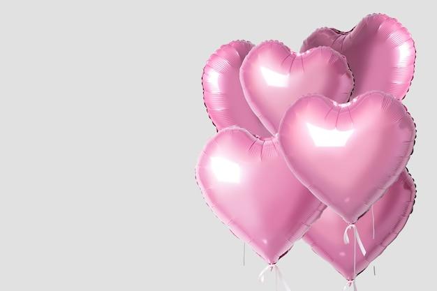 Bouquet de ballons en forme de coeur de couleur rose isolé sur fond clair