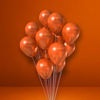 Bouquet de ballons orange sur surface orange