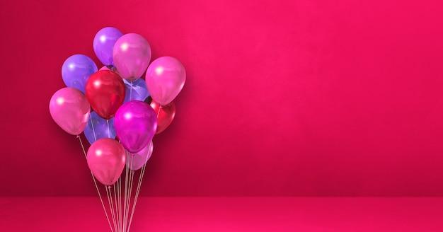 Bouquet de ballons sur une surface rose
