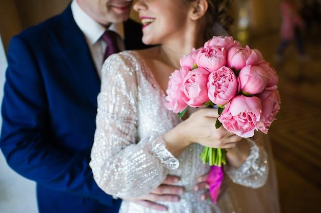 Bouquet de mariée de pivoines roses