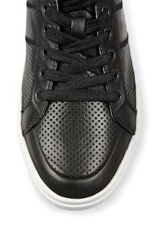 Bout de chaussures de sport isolé sur blanc