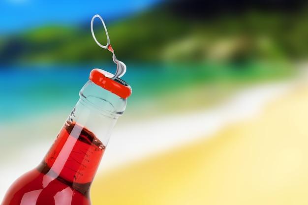 Bouteille de boisson gazeuse sucrée sur la plage