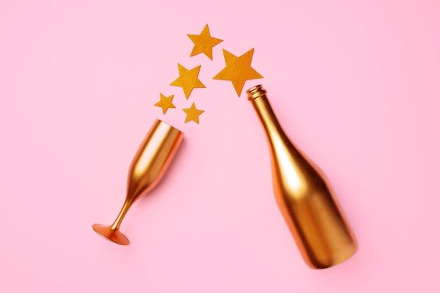 Bouteille de champagne avec étoiles à plat