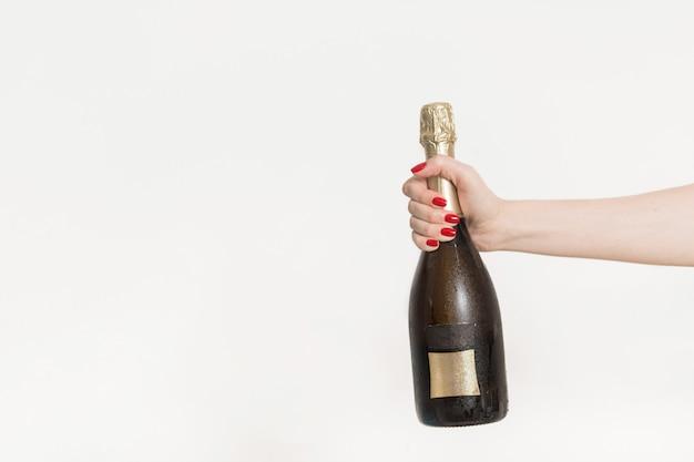 Une bouteille de champagne. lay plat. concept de fête