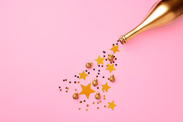 Bouteille de champagne avec vue de dessus plat confettis