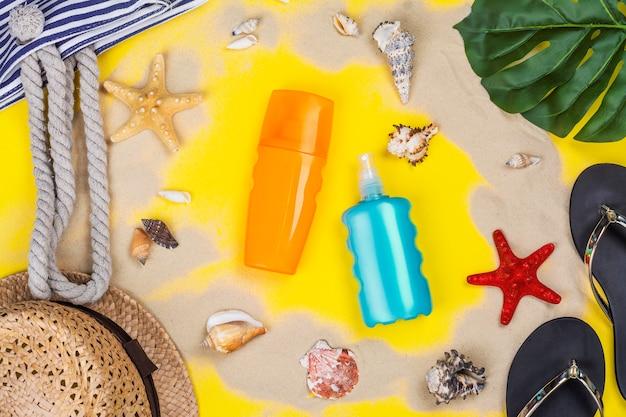 Bouteille de crème solaire et spray