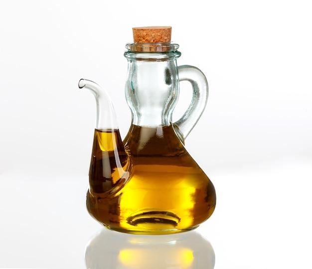 Bouteille d'huile avec le jus d'or de l'olive
