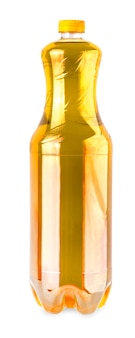 La bouteille avec de l'huile savoureuse isolée