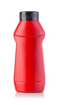 Bouteille de ketchup rouge isolé sur blanc