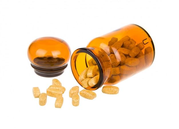 Bouteille ouverte et pilules