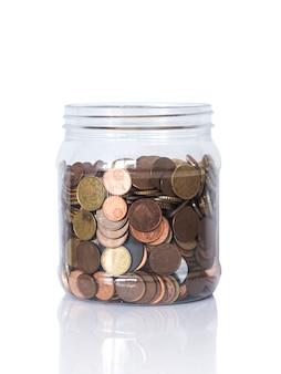 Bouteille avec des pièces en euros