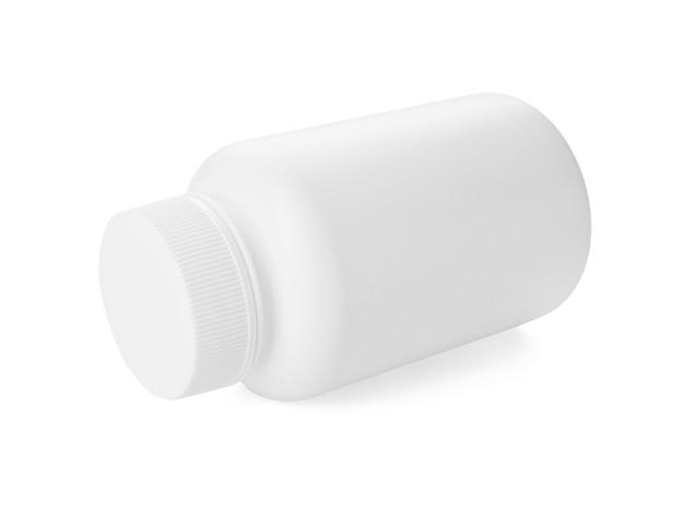 Bouteille de pilules sur blanc