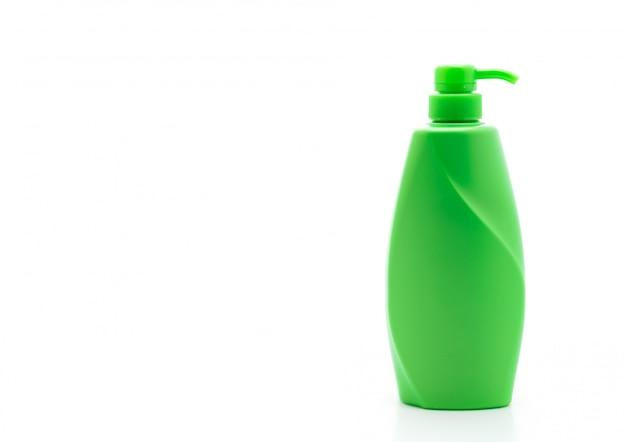 Bouteille de shampooing ou revitalisant sur fond blanc