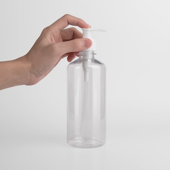 Bouteille transparente en plastique vierge avec pompe sans air de distributeur utilisant une étiquette et des publicités pour gel, savon, alcool, crème et cosmétiques.