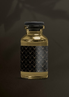Bouteille en verre d'injection de vitamine avec étiquette noire luxueuse pour l'emballage de produits de santé et de bien-être