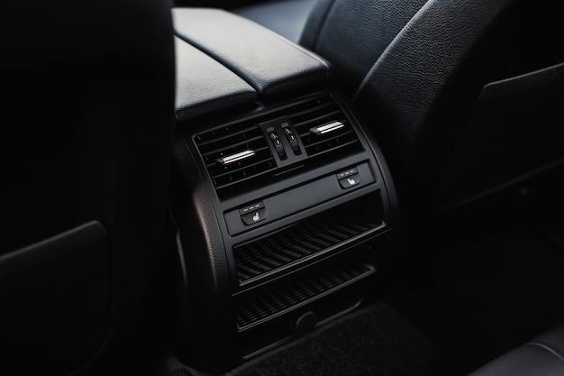 Bouton de chauffage de siège pour les passagers arrière