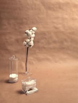 Branche de coton avec des tampons de coton et des bâtons de coton sur un fond d'artisanat