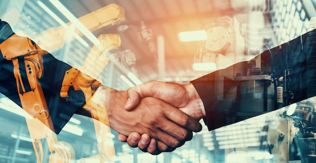 Bras de robot mécanisé de l'industrie et double exposition de poignée de main d'affaires