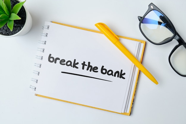Break the bank - anglais argent idiome main lettrage