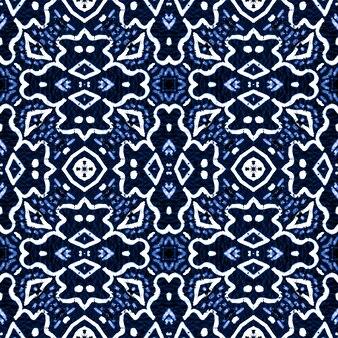 Broderie ethnique indigo. ornement folklorique. modèle sans couture bleu classique.