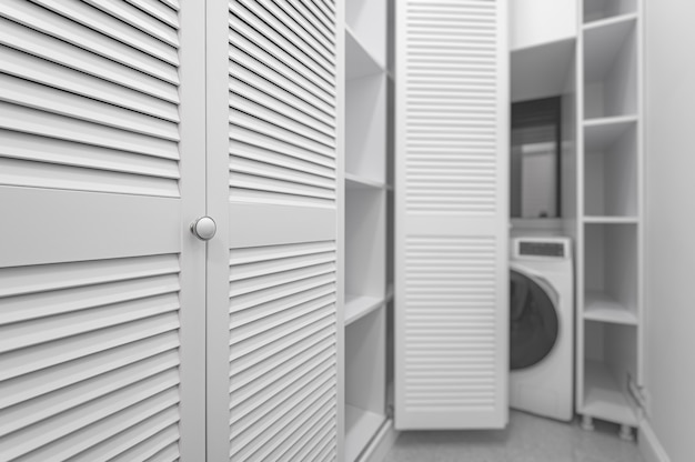 Buanderie blanche à l'intérieur d'une armoire dans un nouvel appartement