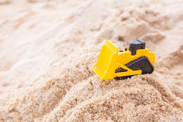 Bulldozer jouet sable de plage en plastique jaune