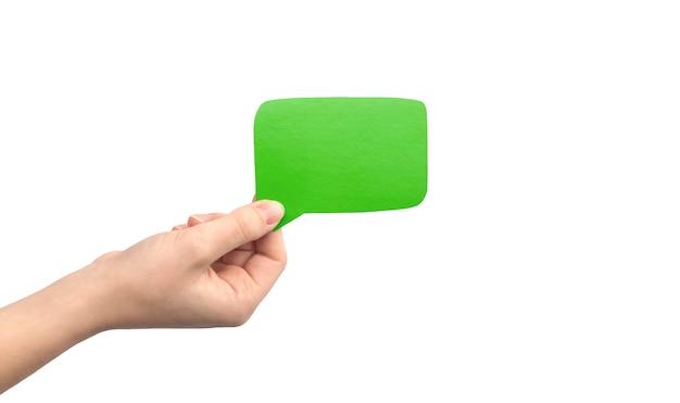 Bulle verte à la main isolée sur fond blanc. donner des commentaires, photo de concept de communication. maquette de zone de texte en carton vide