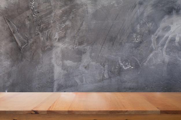 Bureau en bois avec abstrait de texture de mur de ciment