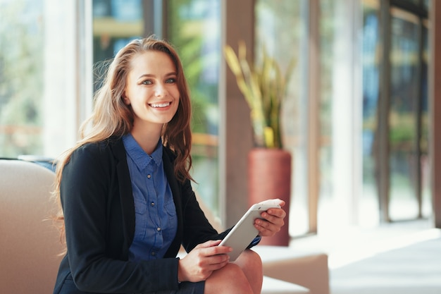 Businesswoman with digital tablet in office