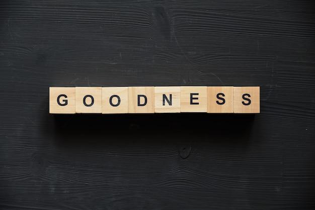Buzzword entreprise moderne - bonté sur des blocs de bois