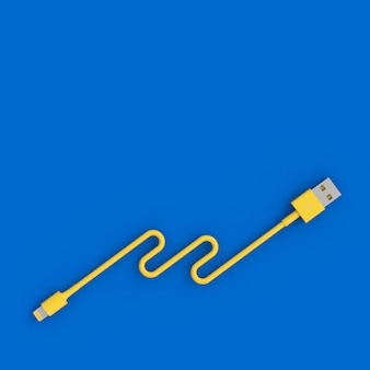 Câble usb jaune sur fond bleu dans un style flatlay.