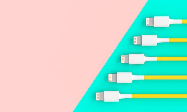 Câbles usb de connexion sur fond bicolore.