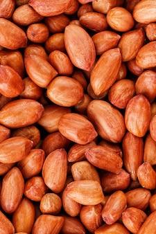 Cacahuètes, pour ou textures. arachides en coque non nettoyées.