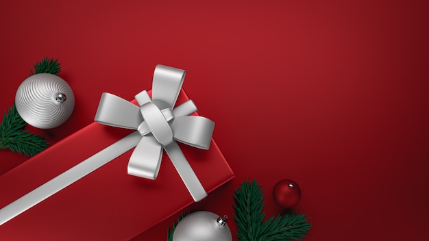 Cadeau du nouvel an, élégante boîte noire avec un ruban d'or, fond plat noir.