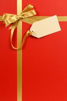 Cadeau de noël de fond avec étiquette de cadeau