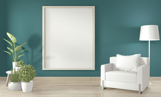 Cadre d'affichage sur le mur, canapé blanc et plantes de décoration sur mur vert foncé et plancher en bois.
