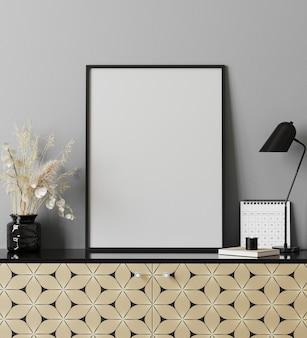 Cadre d'affiche dans un intérieur moderne avec mur gris, lampe de table, calendrier et commode imprimée dorée, intérieur d'armoire de bureau à domicile, rendu 3d