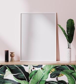 Cadre d'affiche de maquette dans un intérieur de style tropical lumineux avec mur rose, rendu 3d