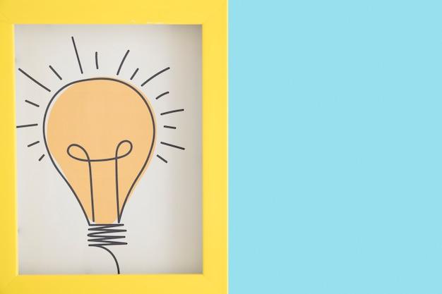 Cadre d'ampoule dessiné main sur fond bleu