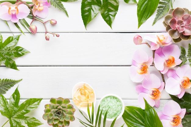 Cadre de beauté et de mode avec spa sur bois rustique pastel.