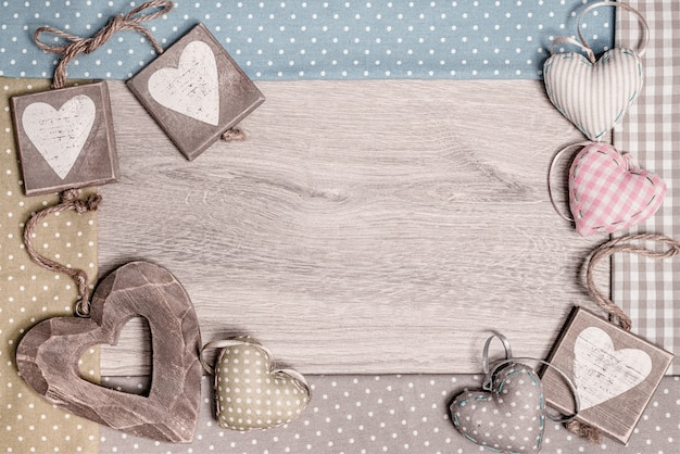 Cadre en bois avec coton et coeurs en bois, espace texte