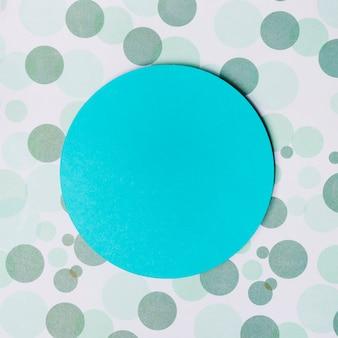 Cadre circulaire turquoise sur fond de pois