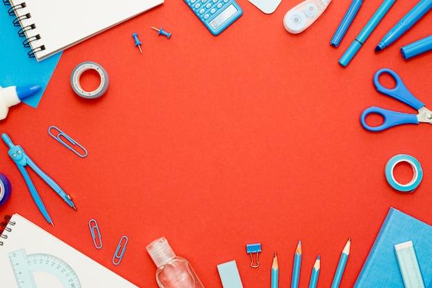 Cadre circulaire vue de dessus avec des articles scolaires